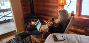 Carol C Lawrence working at the cabin